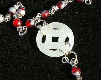 whispers of ruby and silver necklace