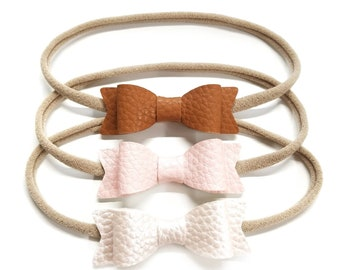 Baby bows, shades of blush, metallic shades, Leather headbands, baby headbands, vanaguelite, hair accessories, baby headbands.