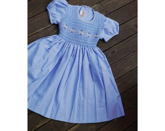 Dress SKY blue cotton for girl, without collar, puffed sleeves with embroidery made by hand, ribbons to tie in the back.