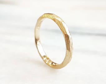 Rustic womens wedding band in 14k yellow gold