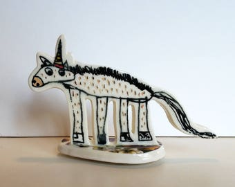 small porcelain unicorn with underglaze drawing, overglaze decals and 22k gold luster
