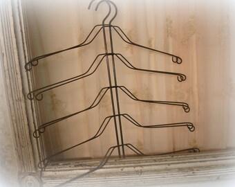 pair vintage arTsy hangers . unUsual metal hangers make the bESt art displays