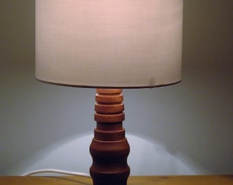 Unique African Sapele wood table lamp 270mm in height.