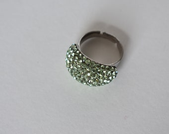 Adjustable Rhinestone Ring with Green Rhinestones Arranged in an Arc and a Silver Tone Adjustable Band