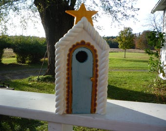 gold and white birdhouse