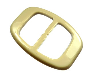 Old beige plastic belt buckles