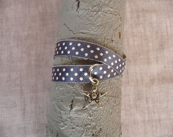 Double Ribbon bracelet with blue satin with white polka dots and charm star