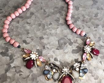 Jewel toned bib style pendant with pink lava beads