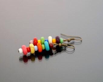 Colorful asymmetrical earrings.