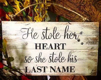 he stole her heart so she stole his last name sign