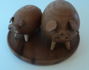 Teak wood salt and pepper shakers (pigs)