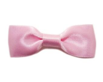 Satin pink bow hair clip.