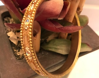 Vintage bangle bracelet in bronze and studded with faux stones