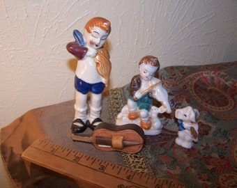 Four porcelain miniature figurines Violin, Playing violin Some made in Japan