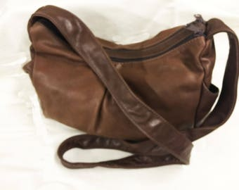 Genuine full grain, soft, leather handbag with 2 zippered compartments, inside zip pocket & 2 end pockets