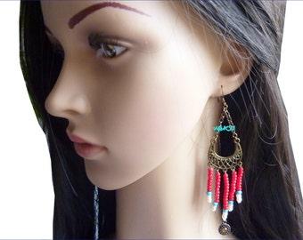 Metal and pearl earrings
