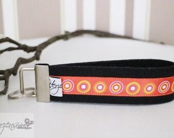 Key chain lanyard made of felt circles orange black
