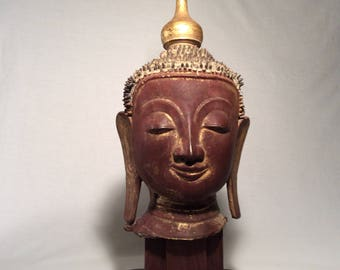 Smiling Lacquer Burmese Buddha Head with Topknot and tropical wood stand, Mid to Late 1800's