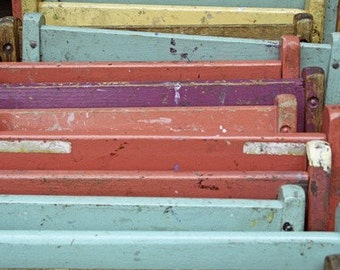 A Stack  of Pastel Folding Chairs Leaning Against the Wall. Fine Art Photo