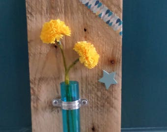 wooden board with upcycled Blue Vase with yellow flowers
