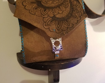 Teal stitched leather bag