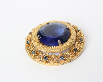 Vintage 1940s to 2000 Sphinx Blue Faceted Rhinestones Goldtone Brooch Pin
