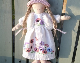 Handmade doll with an embroidered dress