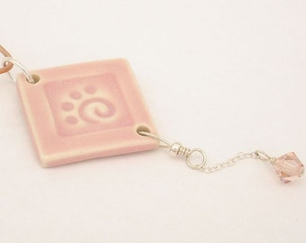 Soft pink stylized paw print on diamond shaped pendant (JSP-P002-1)