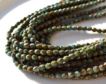 Turquoise PIcasso 4mm Faceted Fire Polish ROund Beads 50