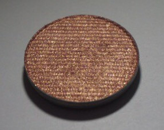 Pegasus Pressed Eyeshadow - Light Toned Copper Base with a pinky orange duochrome Shift
