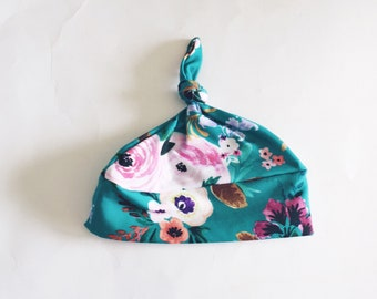 Scalable bow 0-6 month baby Hat pattern pink flowers background green turquoise baby girl