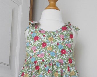 Vintage style pink, blue & yelllow floral cotton dress with shoulder ties. In size 12 and 18 months
