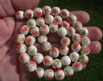 2 RED FLOWERS 10MM CERAMIC BEADS.