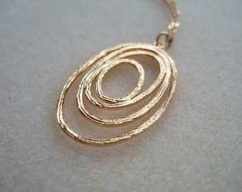 Oval Ripple Pendant Necklace