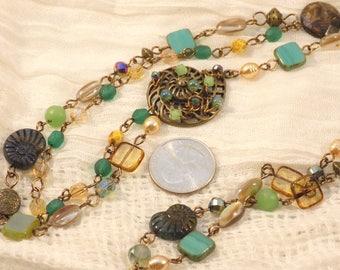 Asymmetric necklace with embellished nautilus