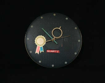 Wall clock, perforated metal, George Nelson & Mategot inspired, Taiwan, late 1980s, Quartz clock