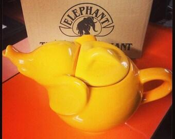 Vintage yellow elephant telliere