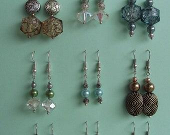 Nine sets of Individually made bead drop ear rings