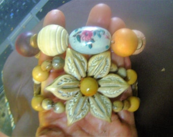 2 wood bracelets with porcelain and seed accents, 1 siza, adjustable