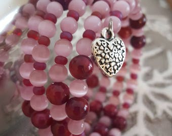 Memory wire bracelet with beautiful pink and dark pink marble glass beads with double sided heart charm