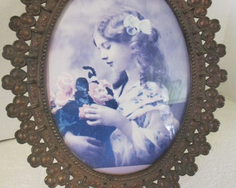 Vintage metal framed young girl with glass front metal frame is from Italy marked 7319-7343