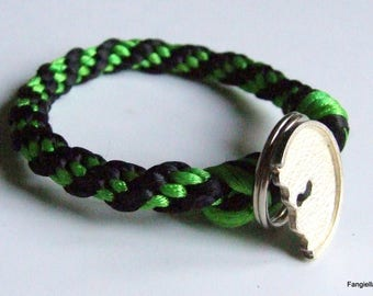 Bracelet is closed with original button green black satin cord