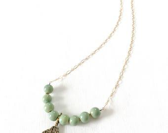 She's Got Faith - brass artisan cross pendant necklace.
