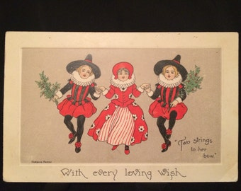 Christmas Postcard by Florence Hardy - Medieval looking Woman and Men