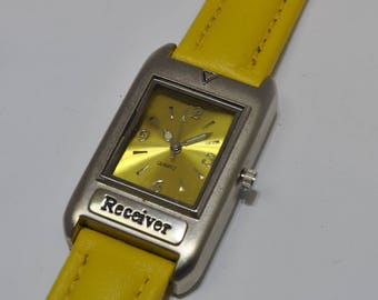 Shows quatrrz Receiver yellow bracelet
