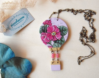 Wooden necklace with hot air balloon. Minesweeper with primroses