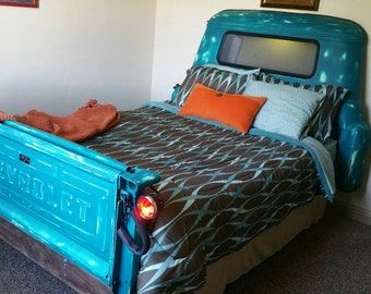 Up Cycled Vintage Queen Size Truck Bed. With working lights and Tailgate. Find yourself sleeping in the most comfortable truck bed ever.
