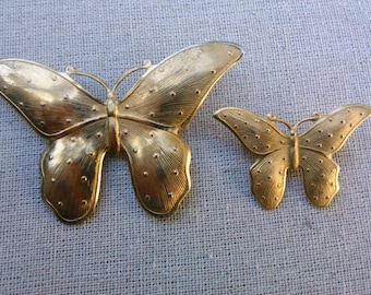 Two vintage beautiful gold tone butterfly brooches