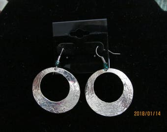 silver disc textured handmade one of a kind