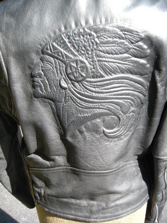 Black leather jacket with indian on back